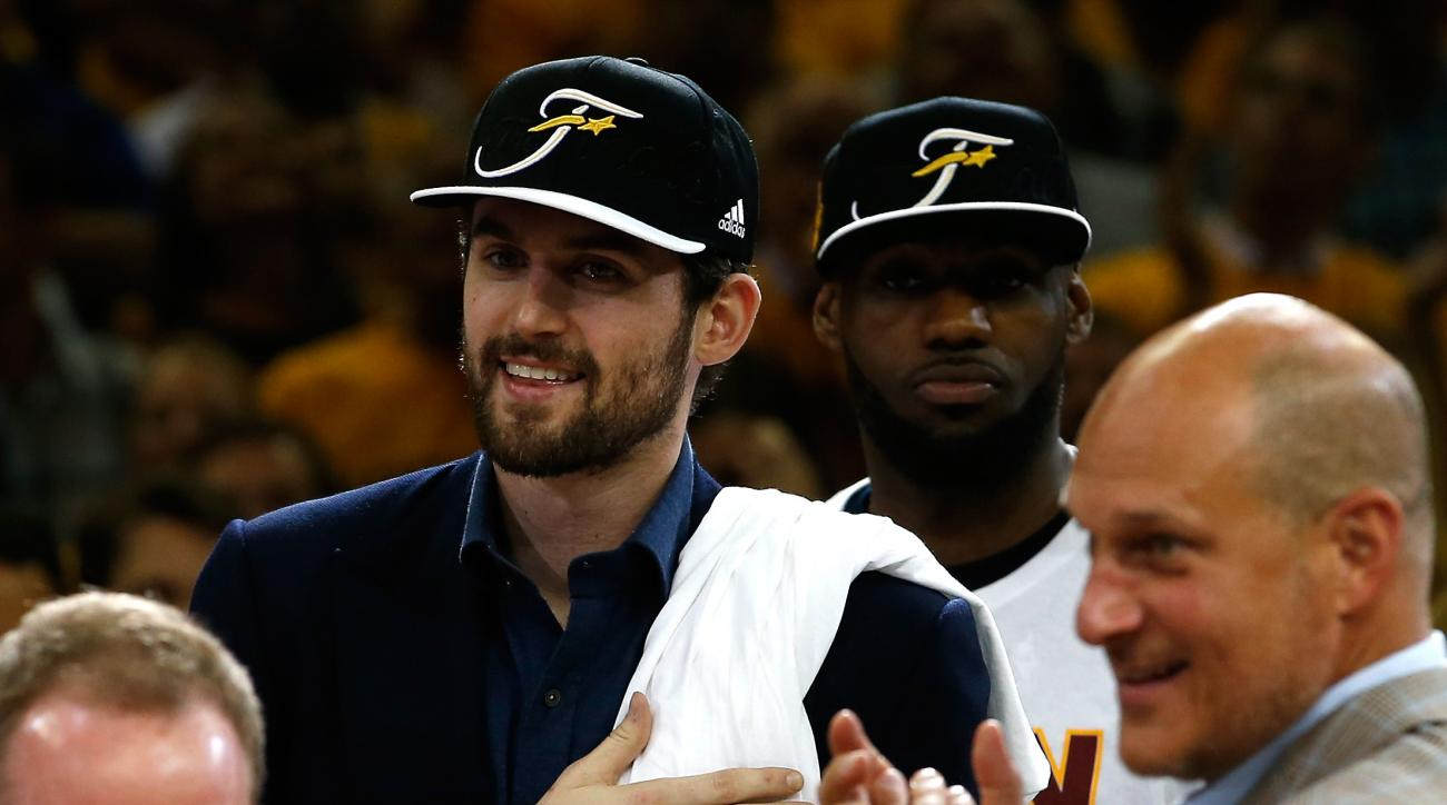 CLEVELAND, OH - MAY 26: Kevin Love #0 and LeBron James #23 of the Cleveland Cavaliers celebrate after defeating the Atlanta Hawks during Game Four of the Eastern Conference Finals of the 2015 NBA Playoffs at Quicken Loans Arena on May 26, 2015 in Clevelan