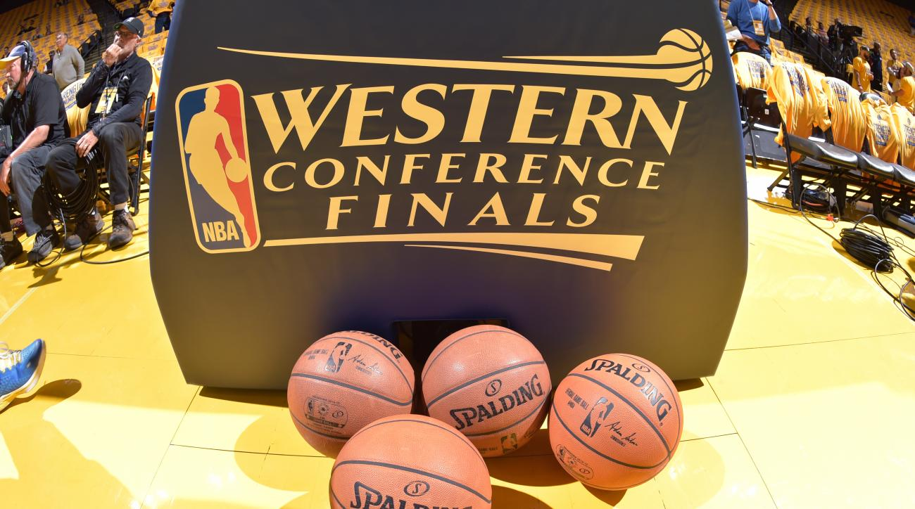 OAKLAND, CA - MAY 19: The Western Conference finals logo with the Official NBA Spalding Basketballs before a game between the Houston Rockets and Golden State Warriors in Game One of the Western Conference Finals of the 2015 NBA Playoffs on May 19, 2015 a