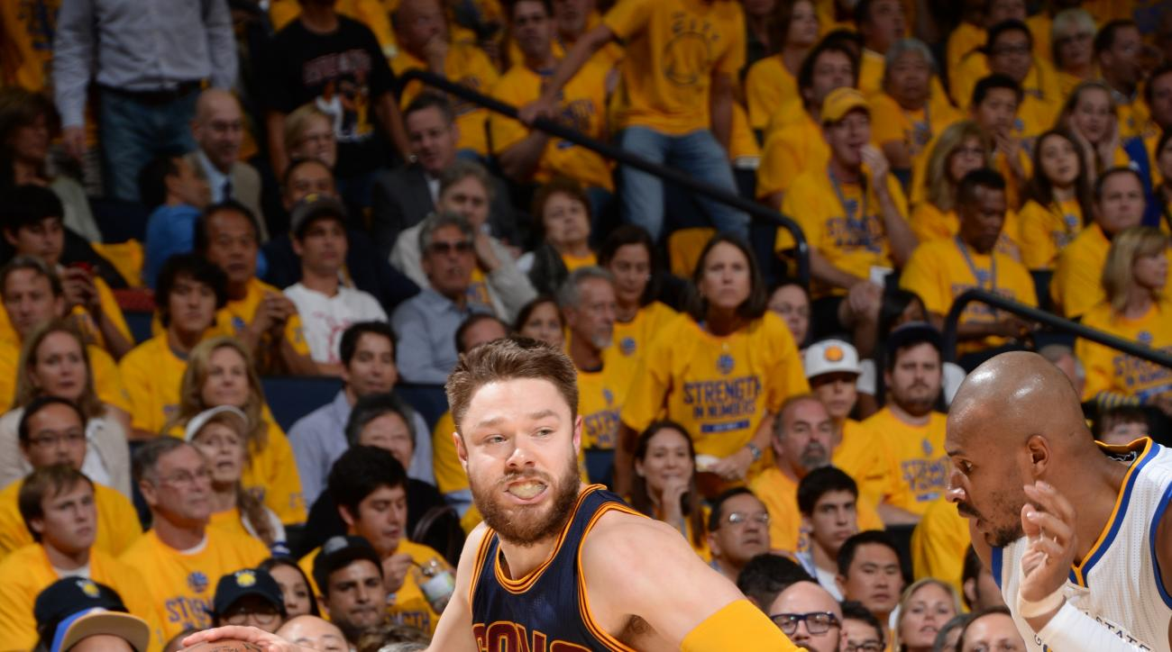 OAKLAND, CA - JUNE 14: Matthew Dellavedova #8 of the Cleveland Cavaliers drives to the basket during Game Five of the 2015 NBA Finals at Oracle Arena on June 14, 2015 in Oakland, California. (Photo by Andrew D. Bernstein/NBAE via Getty Images)