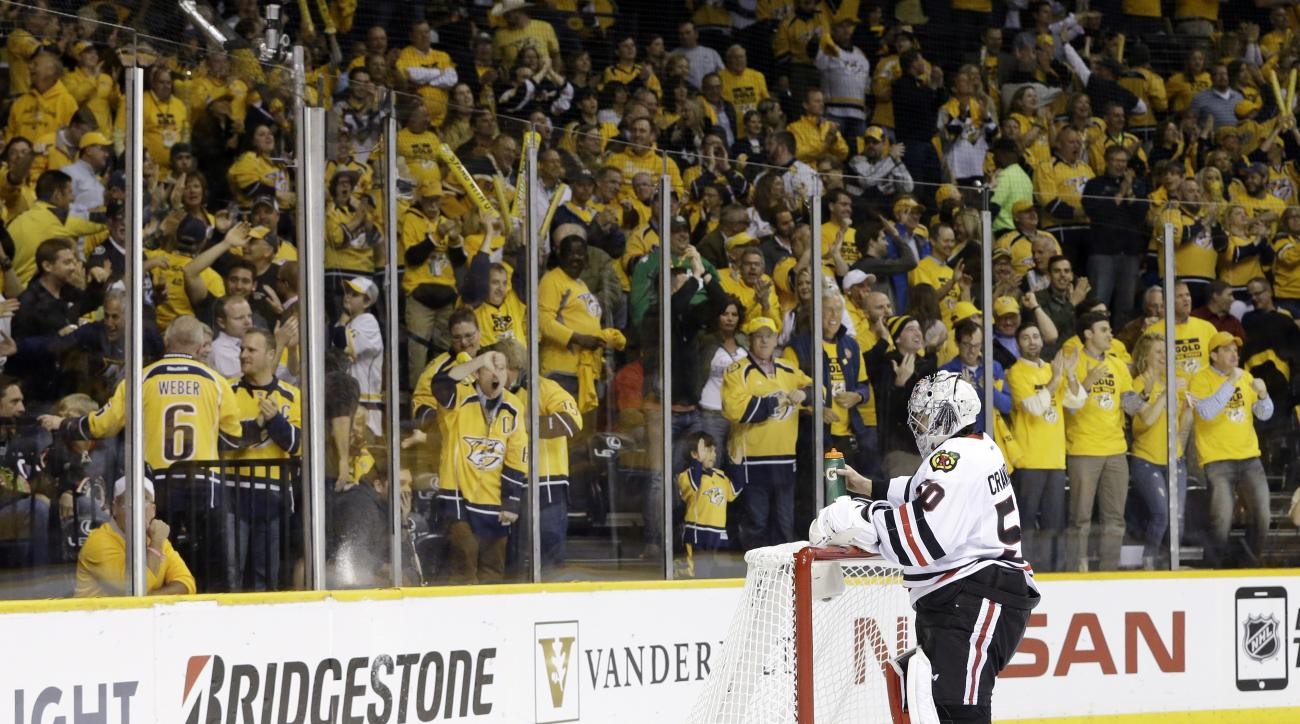 Chicago Blackhawks goalie Corey Crawford (50) gets a drink after Nashville Predators left wing Viktor Stalberg, of Sweden, not shown, scored a goal in the first period of Game 1 of an NHL Western Conference hockey playoff series Wednesday, April 15, 2015,
