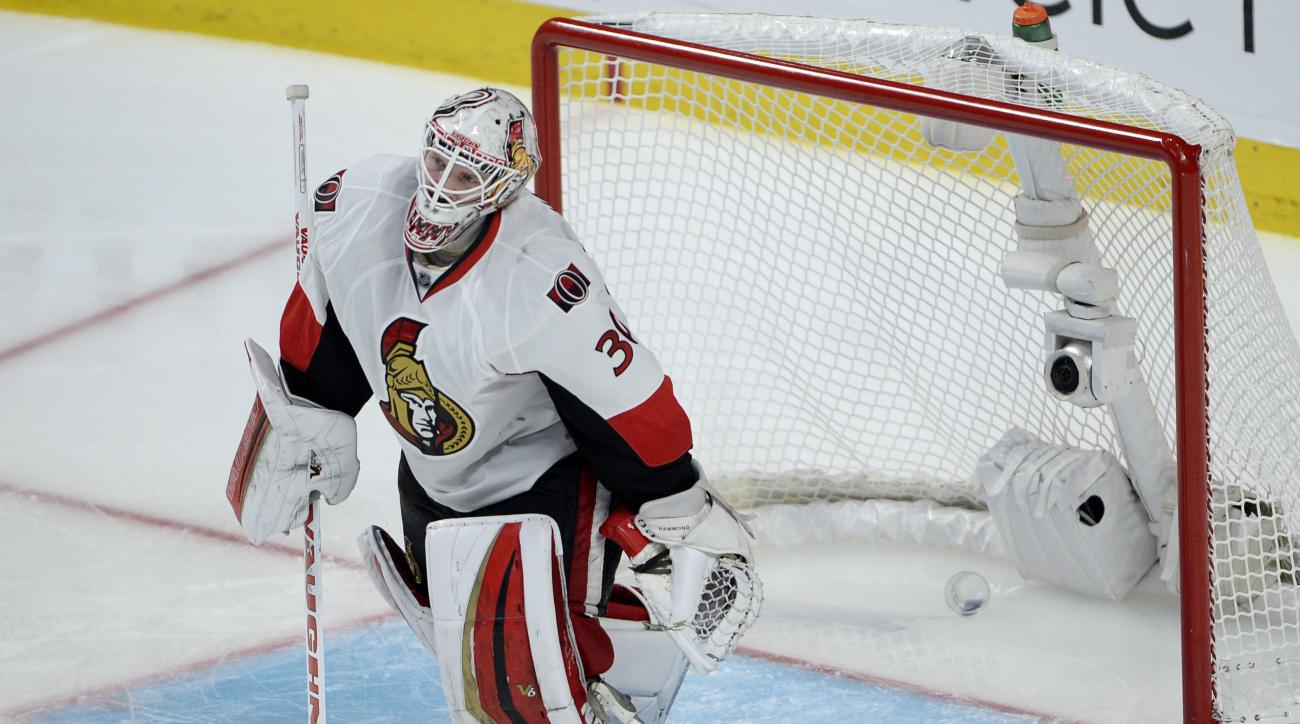 Ottawa Senators goalie Andrew Hammond (30) leaves his crease after letting in the winning goal during the first overtime period in Game 2 of an NHL hockey first-round playoff series, Friday, April 17, 2015 in Montreal. Montreal won 3-2. (Ryan Remiorz/The