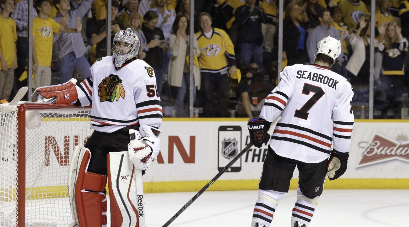 Chicago Blackhawks defenseman Brent Seabrook (7) slaps the leg pad of goalie Corey Crawford (50) after the Nashville Predators scored their sixth goal of the night against Crawford, during the third period of Game 2 of an NHL Western Conference hockey pla