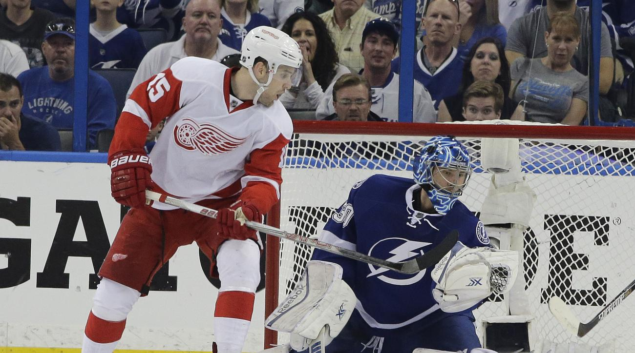 Tampa Bay Lightning goalie Ben Bishop (30) makes a glove save on a shot by Detroit Red Wings center Riley Sheahan (15) during the second period of Game 2 of a first-round NHL Stanley Cup hockey playoff series Saturday, April 18, 2015, in Tampa, Fla. (AP P