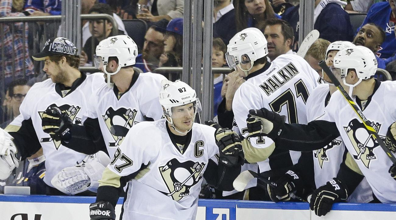 Pittsburgh Penguins' Sidney Crosby (87) celebrates with teammates after scoring a goal during the second period of Game 2 against the New York Rangers in the first round of the NHL hockey Stanley Cup playoffs Saturday, April 18, 2015, in New York. (AP Pho