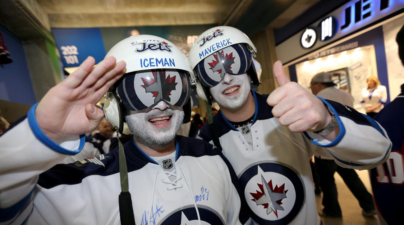 """Winnipeg Jets' fans """"Iceman"""" and """"Maverick"""" pose for a photo prior to game three NHL playoff hockey action against the Anaheim Ducks in Winnipeg, Manitoba, Monday, April 20, 2015. (Trevor Hagan/The Canadian Press via AP)   MANDATORY CREDIT"""