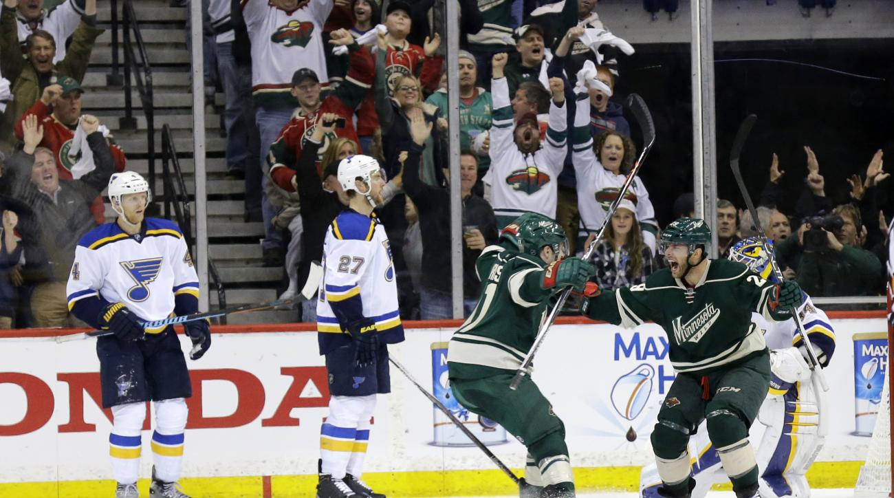 Minnesota Wild right wing Jason Pominville, right,  and teammate Zach Parise, left, celebrate Pominville's goal on St. Louis Blues goalie Jake Allen during the second period of Game 3 of an NHL hockey first-round playoff series game in St. Paul, Minn., Mo