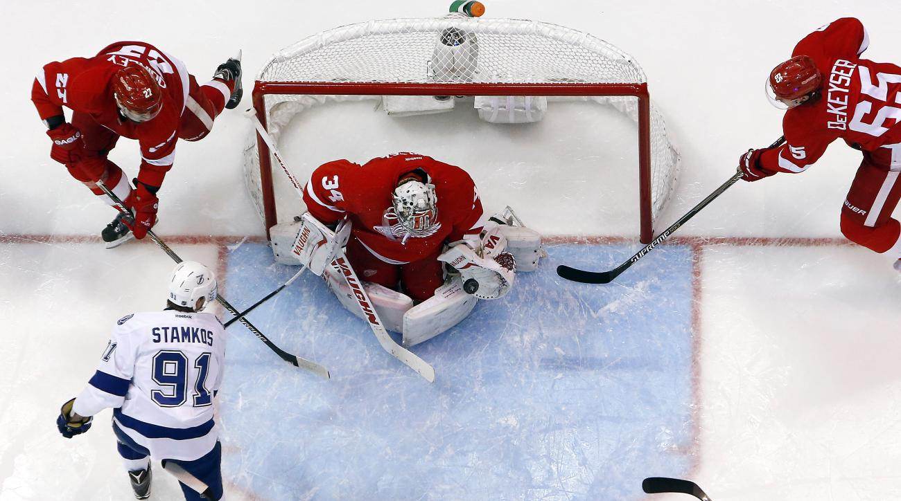 Detroit Red Wings goalie Petr Mrazek (34) stops a Tampa Bay Lightning center Steven Stamkos (91) shot during Game 3 of a first-round NHL Stanley Cup hockey playoff series in Detroit Tuesday, April 21, 2015. Detroit won 3-0. (AP Photo/Paul Sancya)