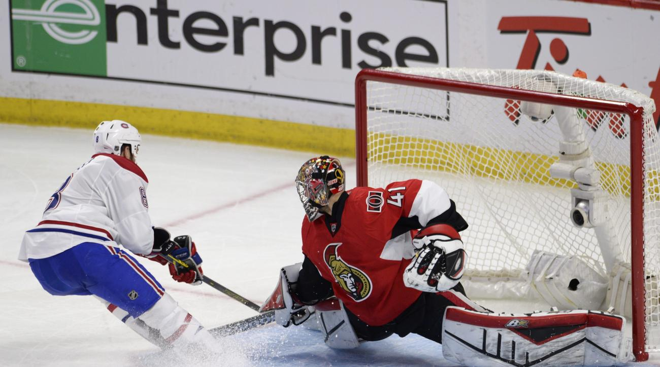 Ottawa Senators goalie Craig Anderson stops Montreal Canadiens' Brandon Prust (8) during the second period in Game 4 of an NHL hockey first-round playoff series, Wednesday, April 22, 2015 in Ottawa, Ontario. (Adrian Wyld/The Canadian Press via AP)  MANDAT