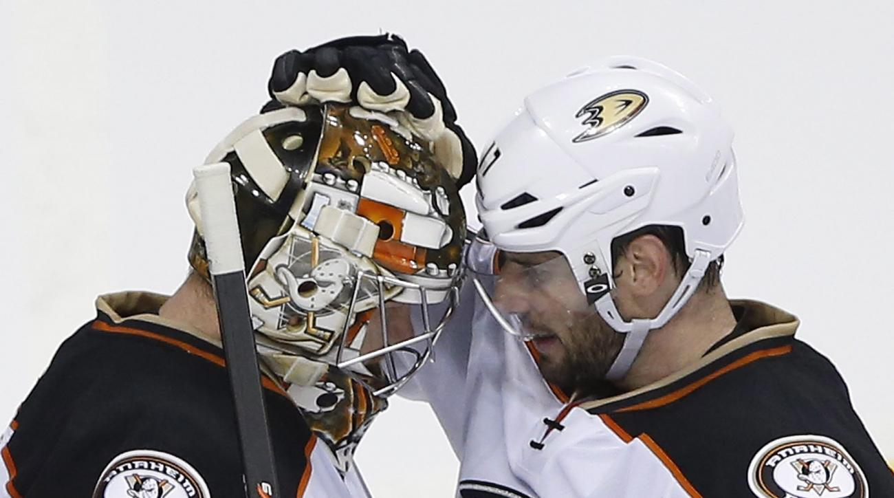 Anaheim Ducks goaltender Frederik Andersen (31) and teammate Ryan Kesler congratulate each other after Game 4 against the Winnipeg Jets in a first-round NHL hockey playoff series, Wednesday, April 22, 2015, in Winnipeg, Manitoba. Anaheim won 5-2 and swept