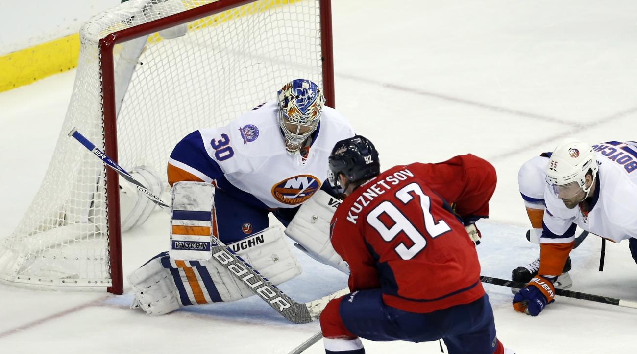 Washington Capitals center Evgeny Kuznetsov (92), from Russia, prepares to shoot as New York Islanders goalie Michal Neuvirth (30), from the Czech Republic, stands ready, during the third period of Game 5 in the first round of the NHL hockey Stanley Cup p