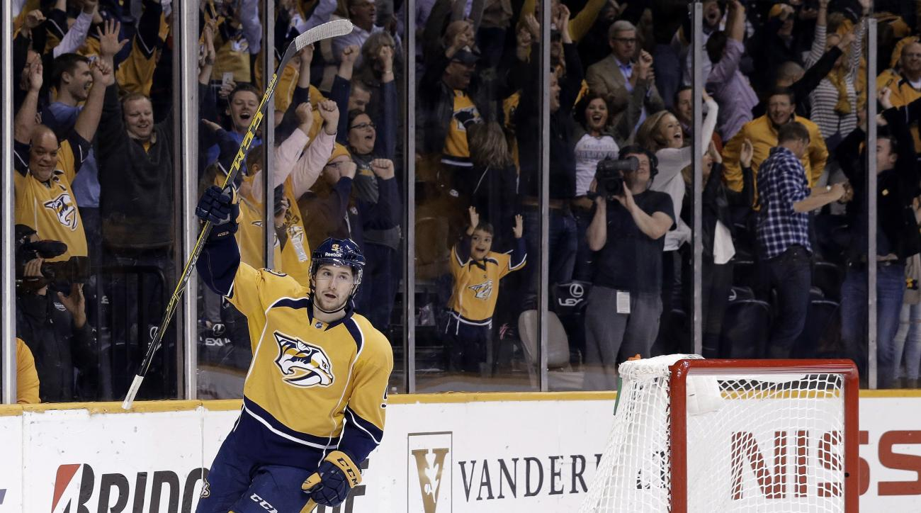 Nashville Predators center Filip Forsberg, of Sweden, celebrates after scoring an empty-net goal against the Chicago Blackhawks for a hat trick, in the third period of Game 5 of an NHL hockey first-round playoff series Thursday, April 23, 2015, in Nashvil