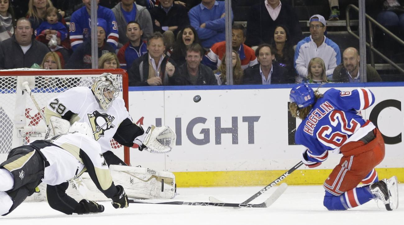New York Rangers' Carl Hagelin (62) shoots against Pittsburgh Penguins' Marc-Andre Fleury (29) during the first period of Game 5 in the first round of the NHL hockey Stanley Cup playoffs, Friday, April 24, 2015, in New York. (AP Photo/Frank Franklin II)
