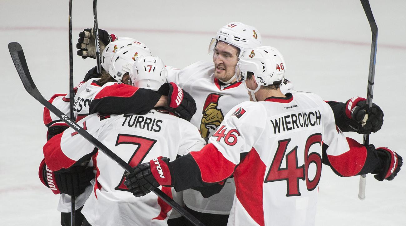 Ottawa Senators' Erik Karlsson, second from left, celebrates with teammates Milan Michalek (9), Kyle Turris (7), Patrick Wiercioch (46) and Mark Stone (61) after scoring against the Montreal Canadiens during the second period of Game 5 of a first-round NH