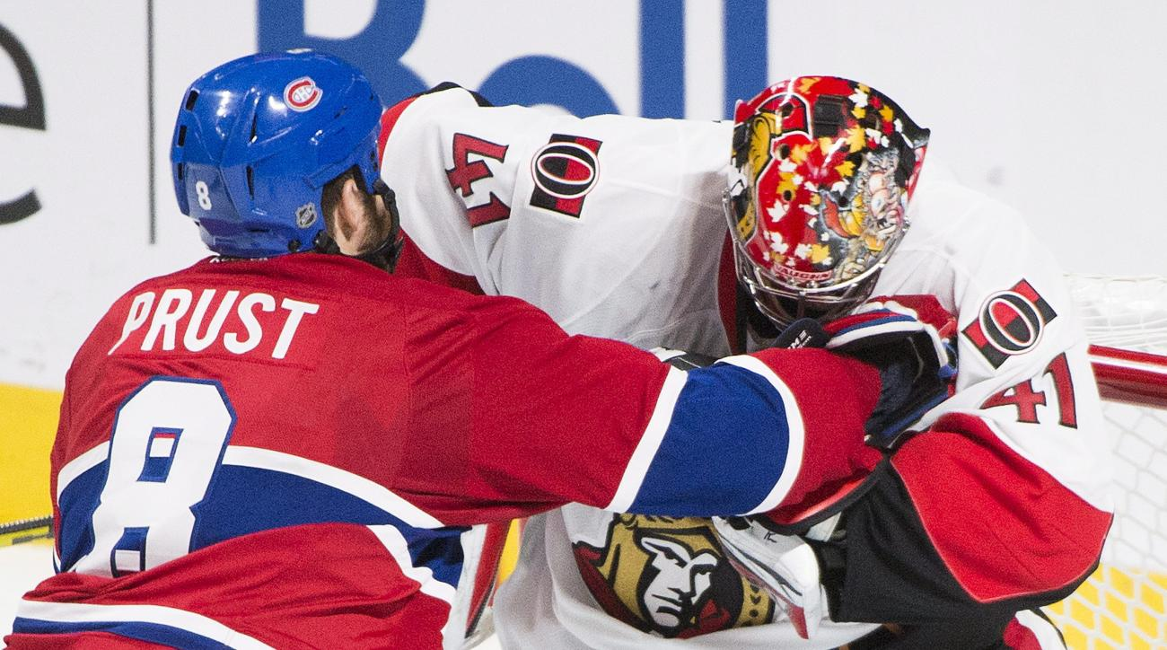 Montreal Canadiens' Brandon Prust (8) cross-checks Ottawa Senators goaltender Craig Anderson during the third period of Game 5 of a first-round NHL hockey playoff series, Friday, April 24, 2015, in Montreal. (Graham Hughes/The Canadian Press via AP)