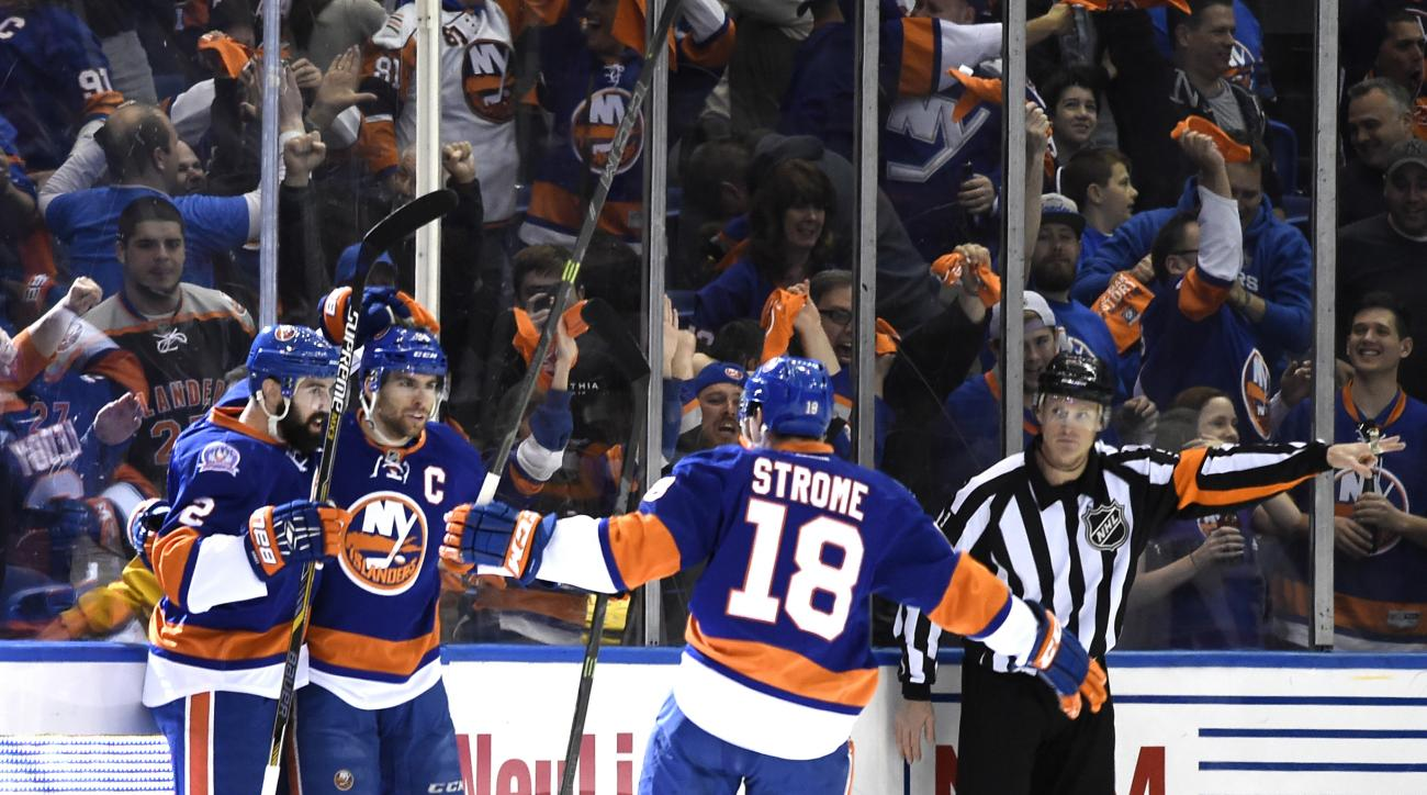 New York Islanders center John Tavares (91), defenseman Nick Leddy (2) and center Ryan Strome (18) celebrate Tavares' goal against the Washington Capitals during the first period in Game 6 in the first round of the NHL hockey Stanley Cup playoffs at Nassa