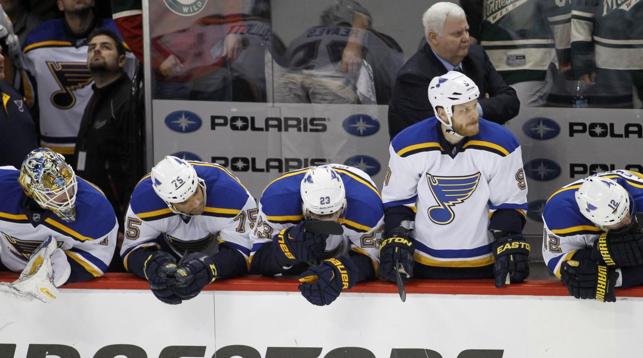 St. Louis Blues goalie Brian Elliott, left,  right wing Ryan Reaves (75),  right wing Dmitrij Jaskin (23), center Steve Ott, and center Jori Lehtera (12) watch from the bench during the final minute of the third period of Game 6 of an NHL hockey first-rou