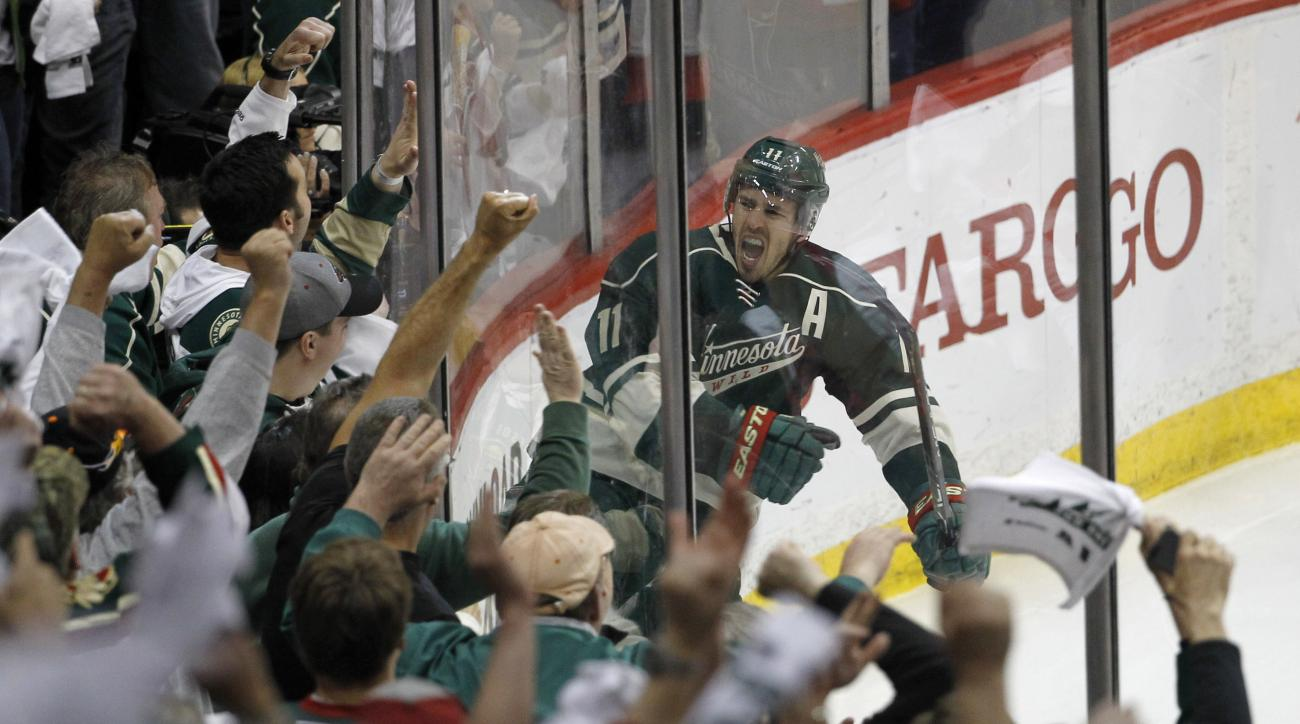 Minnesota Wild left wing Zach Parise reacts in front of the fans after scoring on St. Louis Blues goalie Brian Elliott during the third period of Game 6 of an NHL hockey first-round playoff series in St. Paul, Minn., Sunday, April 26, 2015. The Wild won 4