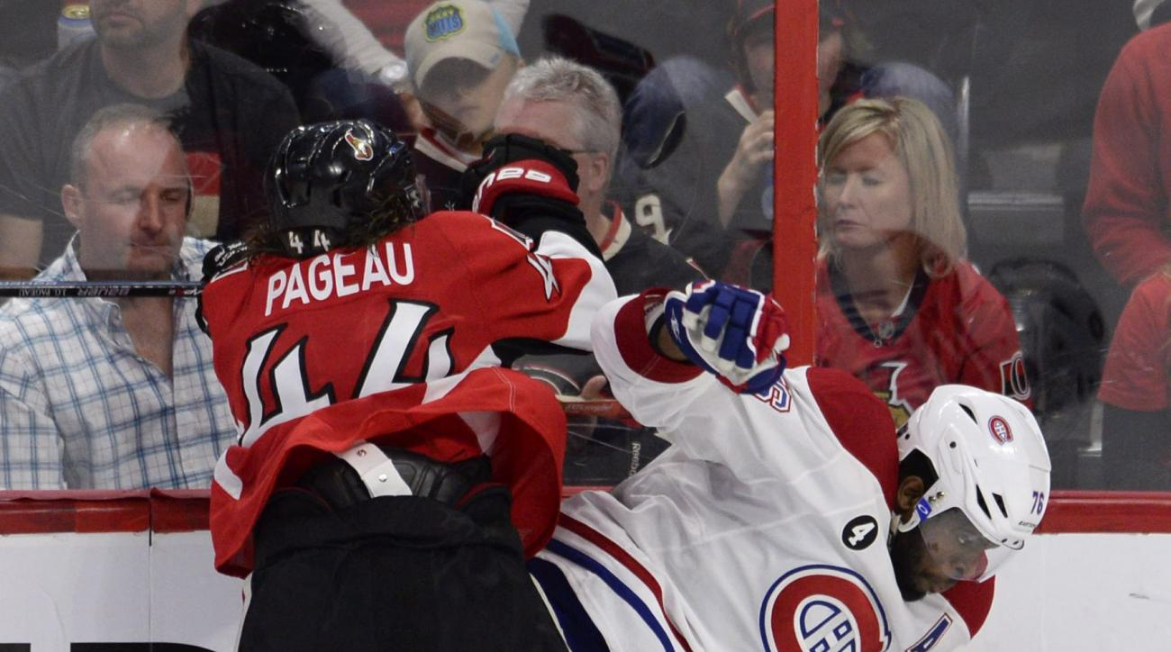 Ottawa Senators' Jean-Gabriel Pageau (44) checks Montreal Canadiens' P.K. Subban (76) during third period NHL playoff action in Ottawa, Ontario, Sunday, April 26, 2015. (Adrian Wyld/The Canadian Press via AP) MANDATORY CREDIT