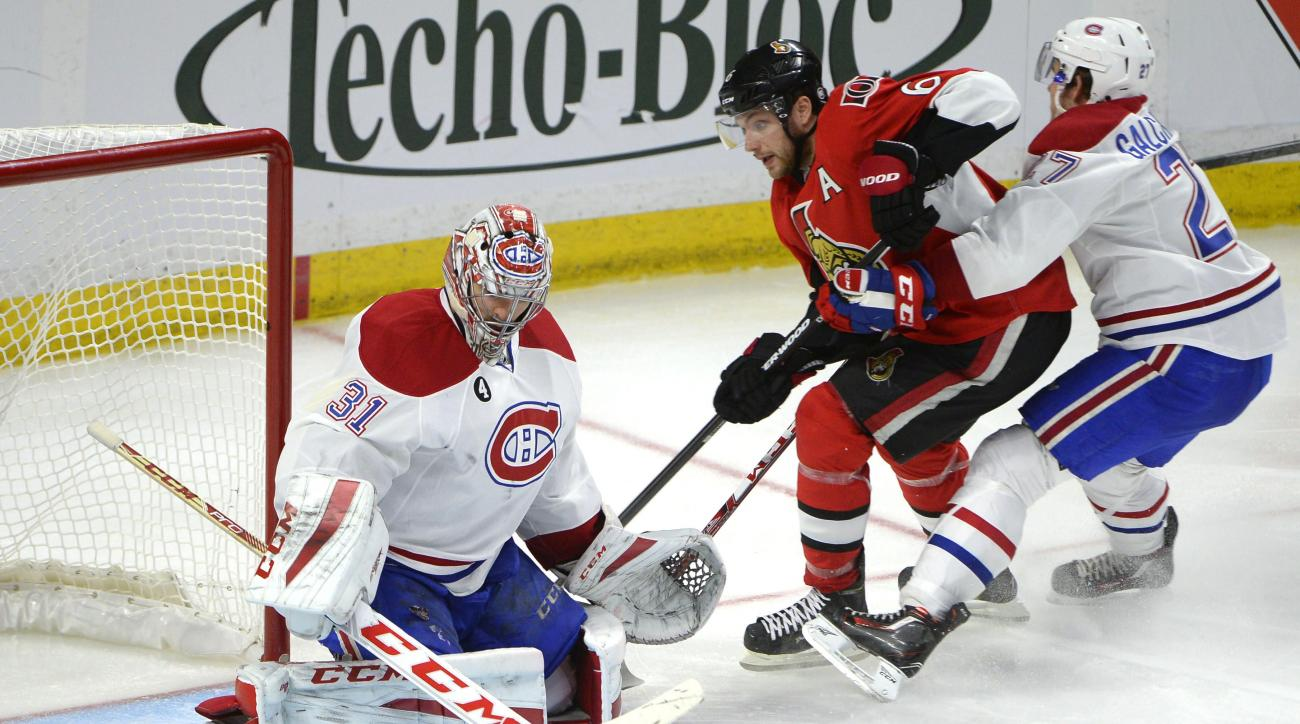 Montreal Canadiens' Carey Price (31) keeps his eye on the puck as Ottawa Senators' Bobby Ryan (6) is boxed out by Canadiens' Alex Galchenyuk (27) during the third period of Game 6 of a first-round NHL hockey playoff series Sunday April 26, 2015, in Ottawa