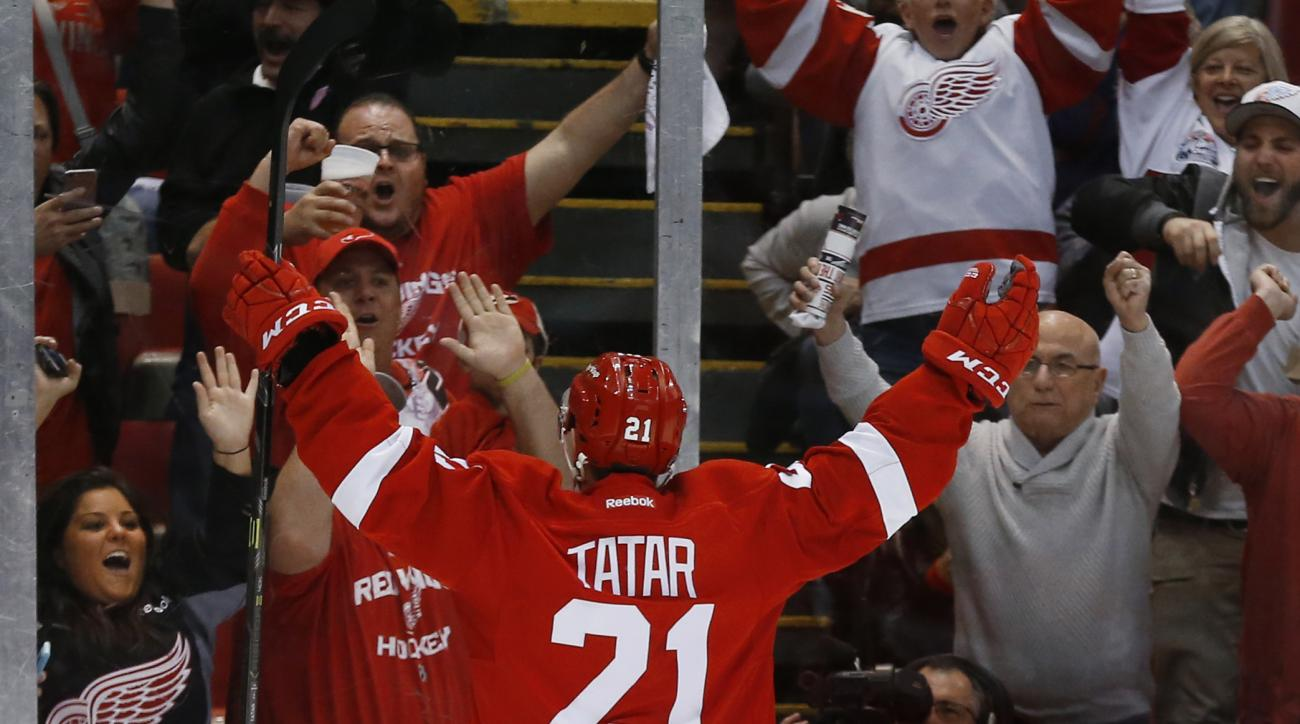 Detroit Red Wings' Tomas Tatar (21) celebrates his goal against the Tampa Bay Lightning in the second period of Game 6 of a first-round NHL Stanley Cup hockey playoff series, Monday, April 27, 2015, in Detroit. (AP Photo/Paul Sancya)