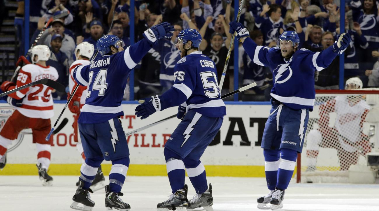 Tampa Bay Lightning defenseman Braydon Coburn (55) celebrates his goal against the Detroit Red Wings with teammates right wing Ryan Callahan (24) and center Steven Stamkos (91) during the third period of Game 7 of a first-round NHL Stanley Cup hockey play