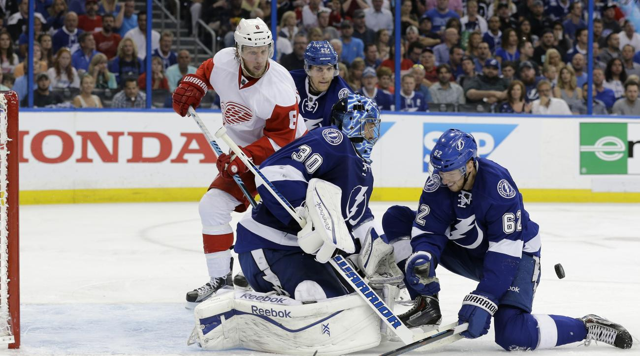 Tampa Bay Lightning goalie Ben Bishop (30) and defenseman Andrej Sustr (62), of the Czech Republic, stop shot by Detroit Red Wings left wing Justin Abdelkader (8) during the third period of Game 7 of a first-round NHL Stanley Cup hockey playoff series Wed