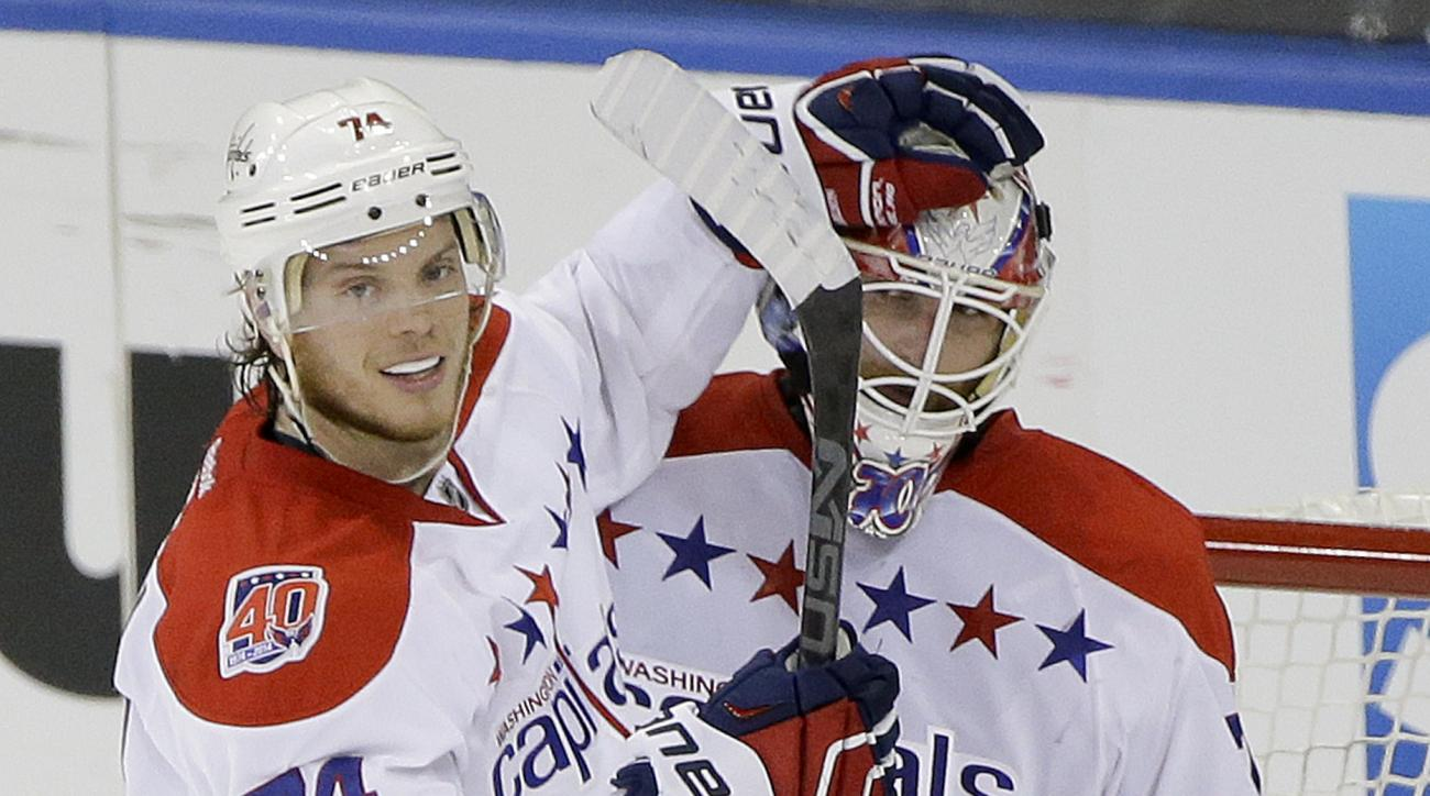 Washington Capitals defenseman John Carlson (74) congratulates goalie Braden Holtby (70) after the Capitals defeated the New York Rangers 2-1 in Game 1 of the second round of the NHL Stanley Cup hockey playoffs Thursday, April 30, 2015, in New York. (AP P