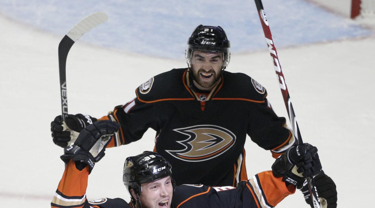 Anaheim Ducks' Matt Beleskey, front, followed by teammate Kyle Palmieri, celebrates his goal against the Calgary Flames during the first period of Game 1 in the second round of the NHL Stanley Cup hockey playoffs, Thursday, April 30, 2015, in Anaheim, Cal