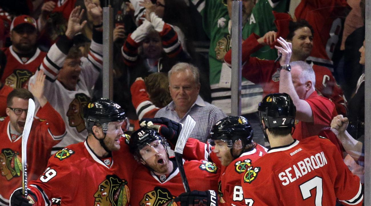 Chicago Blackhawks right wing Patrick Kane, second from right, celebrates with left wing Bryan Bickell, left, center Brad Richards and defenseman Brent Seabrook, right, after scoring his goal during the first period of Game 1 in the second round of the NH