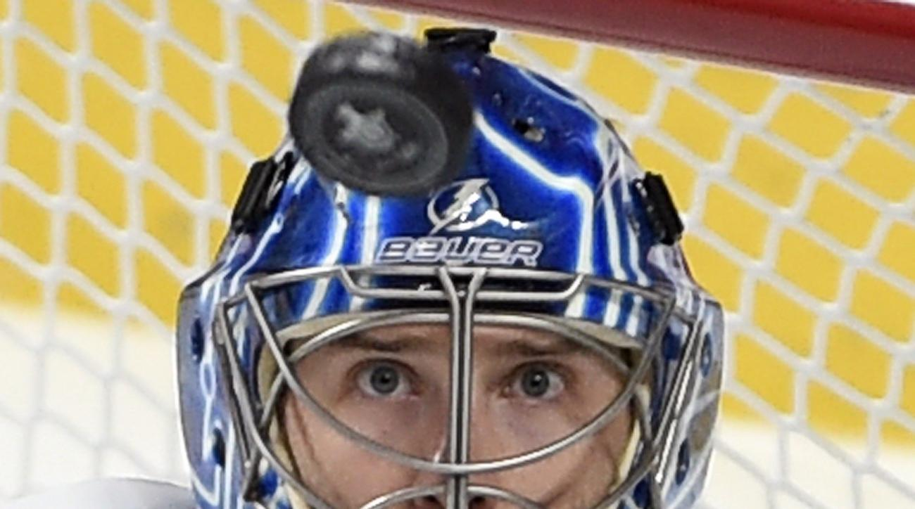 Tampa Bay Lightning goalie Ben Bishop keeps his eyes on the puck during the overtime period against the Montreal Canadiens in Game 1 of second-round playoff NHL hockey action Friday, May 1, 2015, in Montreal. (Ryan Remiorz/The Canadian Press via AP) MANDA