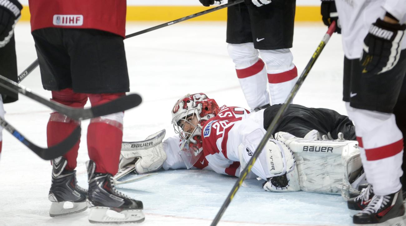 Austria's goalkeeper Bernhard Starkbaum lies on the ice during the Hockey World Championships Group A match against Switzerland in Prague, Czech Republic, Saturday, May 2, 2015. (AP Photo/Petr David Josek)