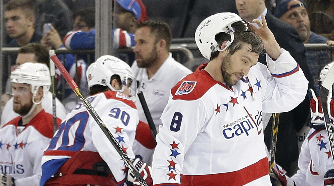 Washington Capitals left wing Alex Ovechkin (8) adjusts his helmet during a break in play against the New York Rangers during the first period of Game 2 in the second round of the NHL Stanley Cup hockey playoffs Saturday, May 2, 2015, in New York. (AP Pho