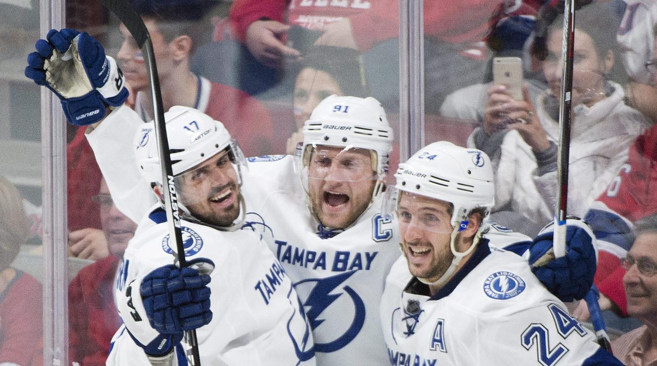 Tampa Bay Lightning's Steven Stamkos, center, celebrates with teammates Alex Killorn (17) and Ryan Callahan after scoring against the Montreal Canadiens during second period of Game 2 NHL second round playoff hockey action in Montreal, Sunday, May 3, 2015