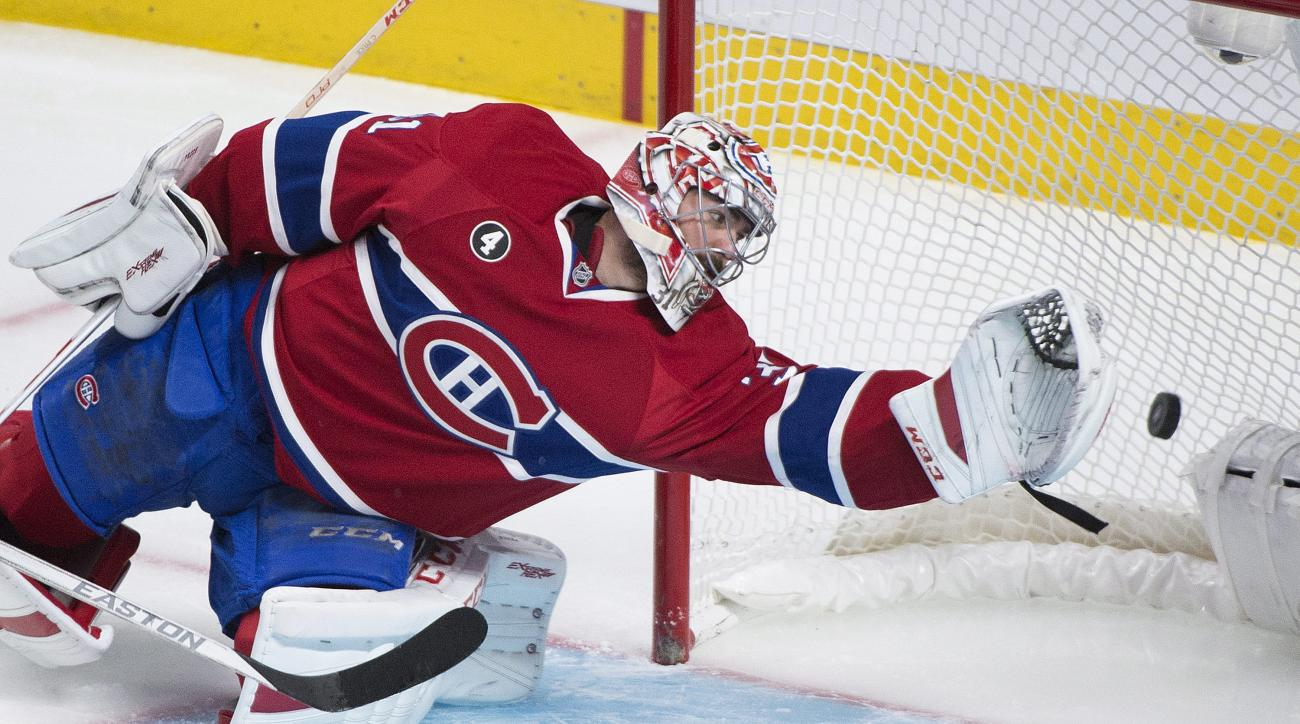 Montreal Canadiens goaltender Carey Price is scored on by Tampa Bay Lightning's Nikita Kucherov during second period of Game 2 NHL second round playoff hockey action in Montreal, Sunday, May 3, 2015. (Graham Hughes/The Canadian Press via AP)   MANDATORY C
