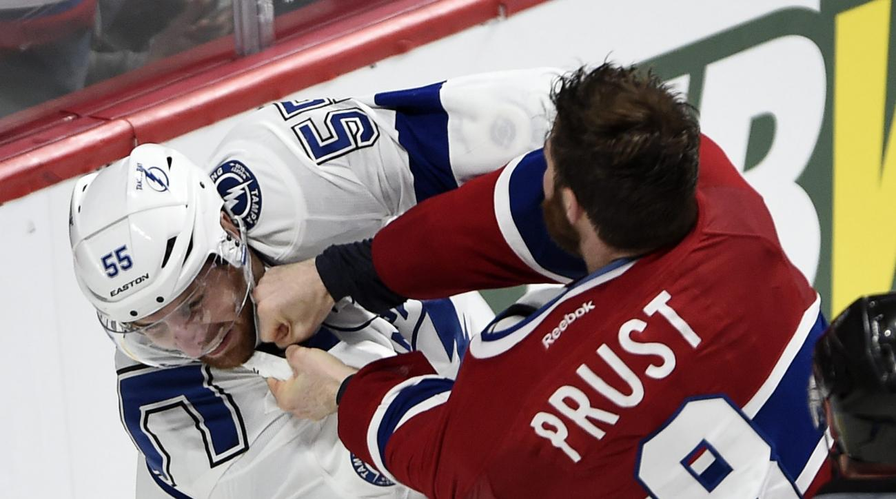 Montreal Canadiens winger Brandon Prust (8) fights with Tampa Bay Lightning defenceman Braydon Coburn (55) during third period of Game 2 NHL second round playoff hockey action Sunday, May 3, 2015 in Montreal.  (Ryan Remiorz(/The Canadian Press via AP)   M