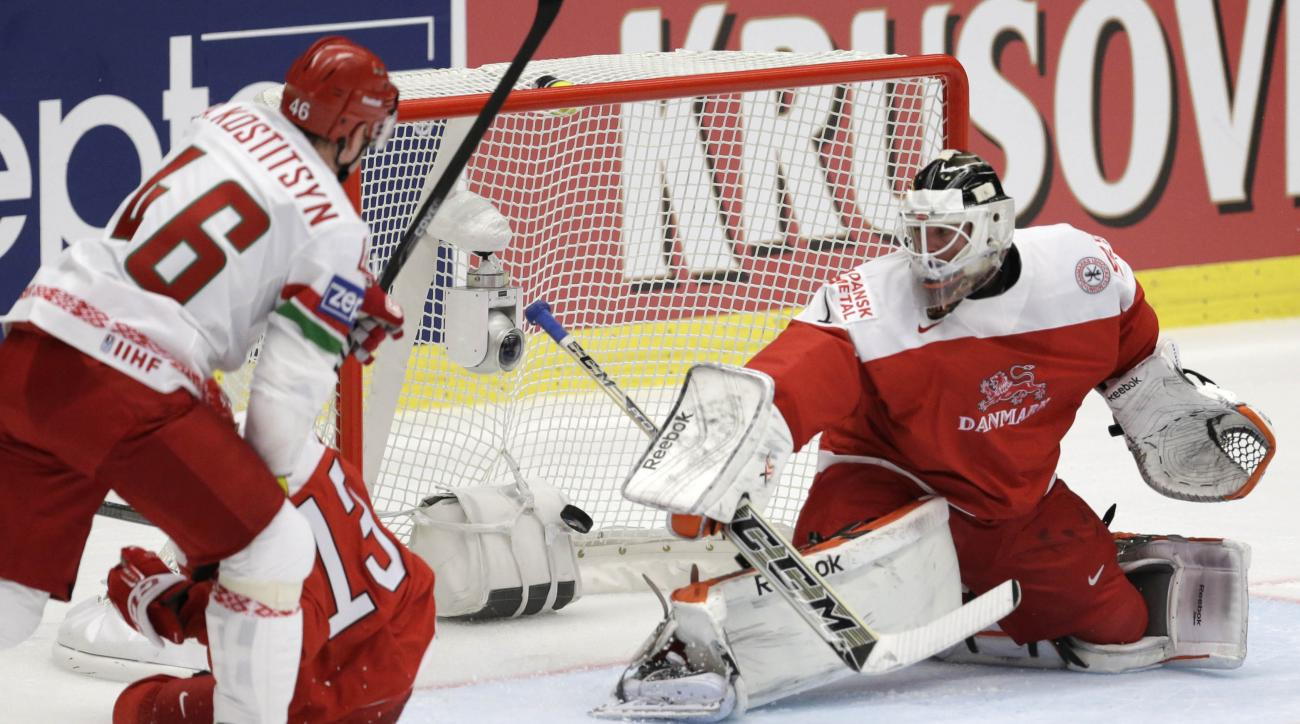 Denmark's Patrick Galbraith, right, fails to stop a goal by Belarus' Ilya Shinkevich during the Hockey World Championships Group B match in Ostrava, Czech Republic, Tuesday, May 5, 2015. (AP Photo/Sergei Grits)