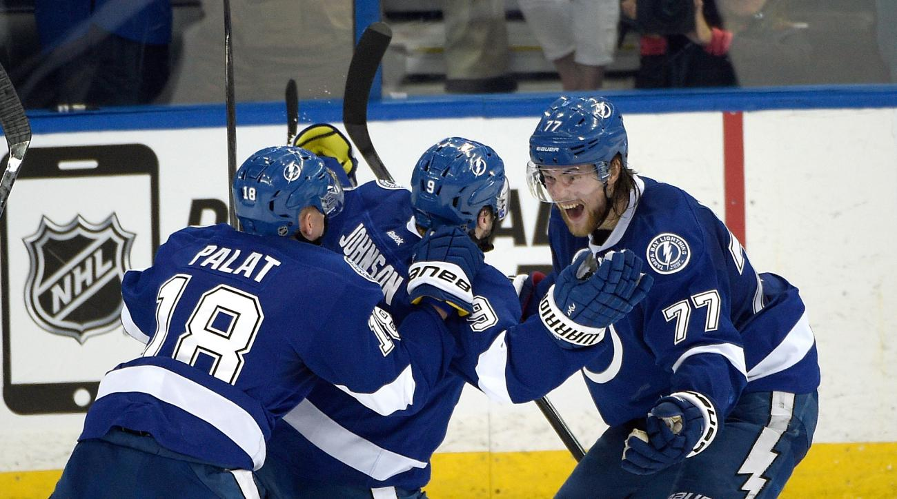 Tampa Bay Lightning center Tyler Johnson (9) celebrates with left wing Ondrej Palat (18), of the Czech Republic, and defenseman Victor Hedman (77) after scoring the winning goal at the end of the third period of Game 3 of a second-round NHL Stanley Cup ho