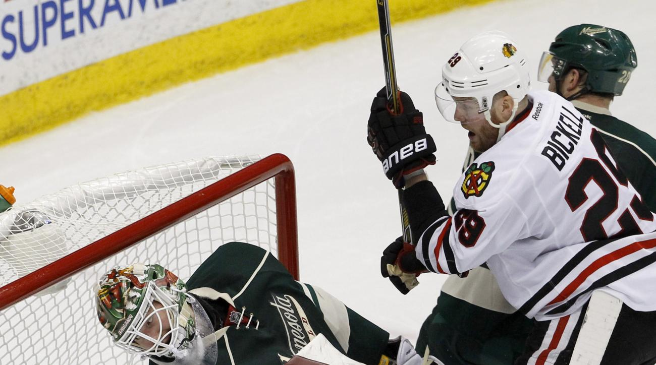 Chicago Blackhawks left wing Bryan Bickell (29) watches as a shot by Blackhawks right wing Patrick Kane gets past Minnesota Wild goalie Devan Dubnyk for a goal during the third period of Game 4 in the second round of the NHL Stanley Cup hockey playoffs, T