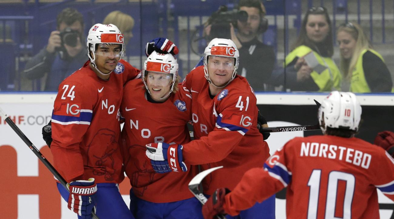 Norway's Patrick Thoresen, second from right, celebrates with his teammate after scoring against Slovenia during the Hockey World Championships Group B match in Ostrava, Czech Republic, Friday, May 8, 2015. (AP Photo/Sergei Grits)