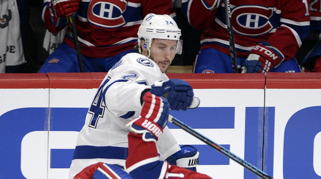 Montreal Canadiens right wing Brendan Gallagher (11) is checked by Tampa Bay Lightning right wing Ryan Callahan (24) during the first period of Game 5 of a second-round NHL Stanley Cup hockey playoff series Saturday, May 9, 2015, in Montreal. (Ryan Remior