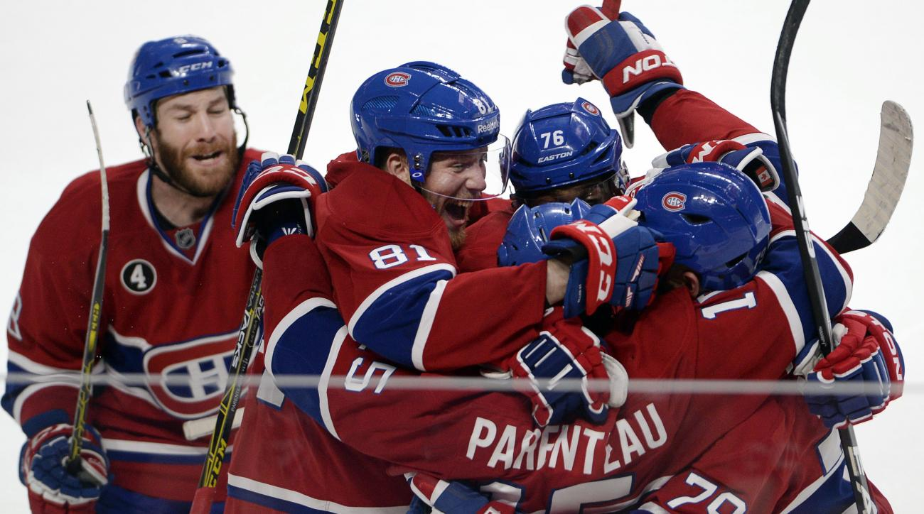 Montreal Canadiens right wing P.A. Parenteau (15) celebrates with teammates Andrei Markov (79), P.K. Subban (76), Lars Eller(81) and Brandon Prust, left, after scoring the winning goal against the Tampa Bay Lightning during the third period of Game 5 of a