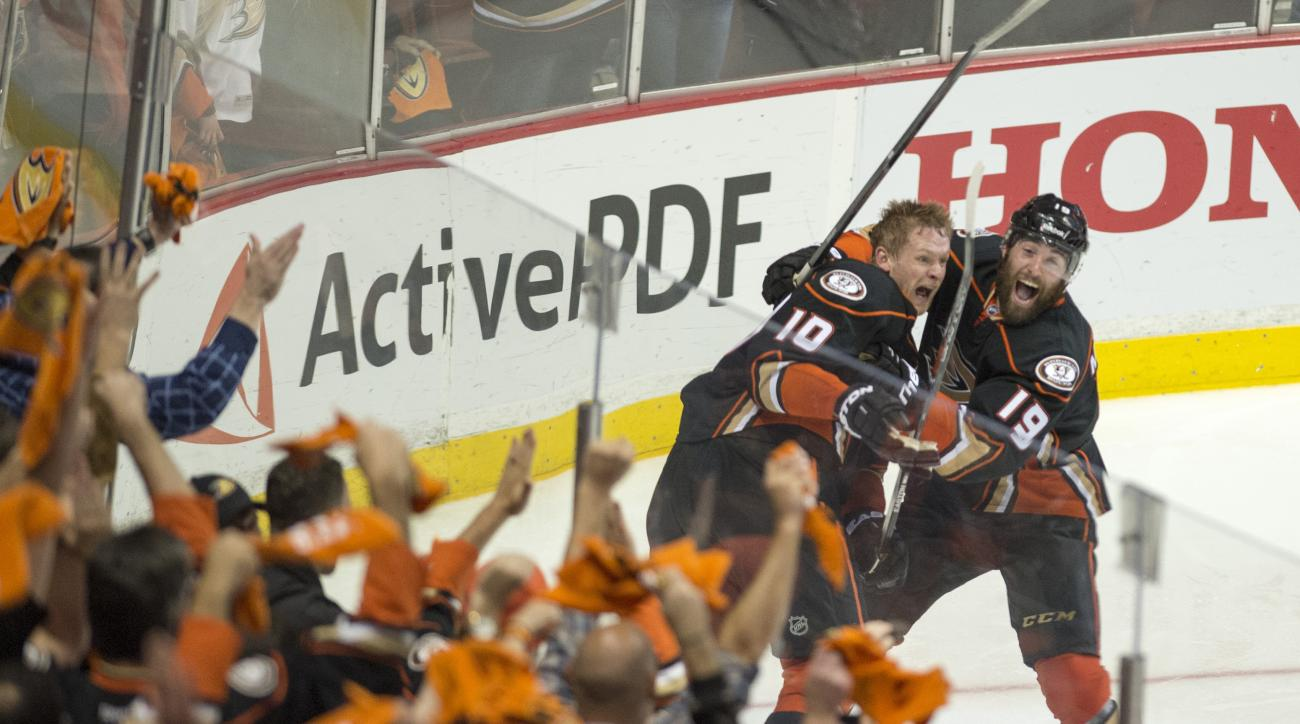 Anaheim Ducks' right wing Corey Perry (10) and teammate Patrick Maroon (19) celebrate Perry's game-winning goal in a 3-2 overtime win against Calgary in Game 5 of a second-round series in the NHL hockey playoffs in Anaheim, Calif., Sunday, May 10, 2015.