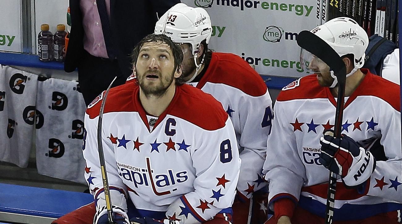 Washington Capitals left wing Alex Ovechkin (8) takes break during a time out against the New York Rangers during the third period of Game 7 of the Eastern Conference semifinals during the NHL hockey Stanley Cup playoffs, Wednesday, May 13, 2015, in New Y