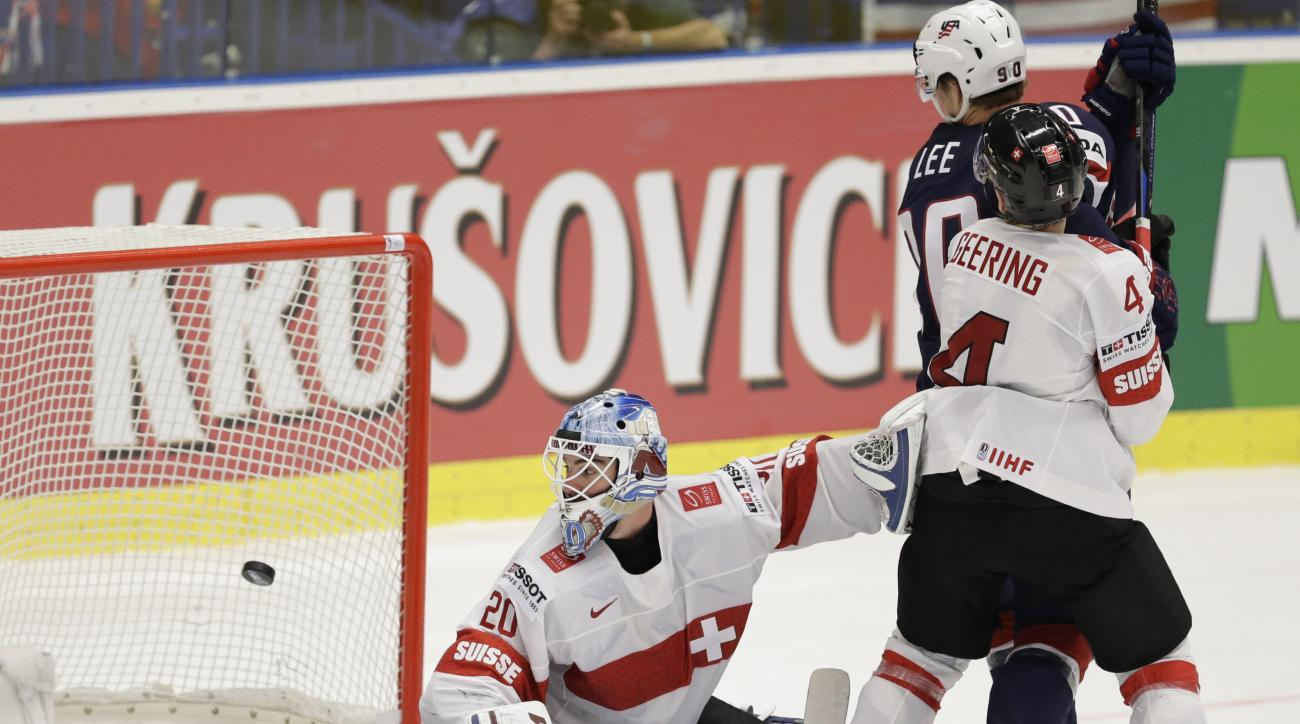 Switzerland's goalkeeper Reto Berra misses a shot from Jake Gardiner, of the United States, unseen, during the Hockey World Championships quarterfinal match between United States and Switzerland, in Ostrava, Czech Republic, Thursday, May 14, 2015. (AP Pho