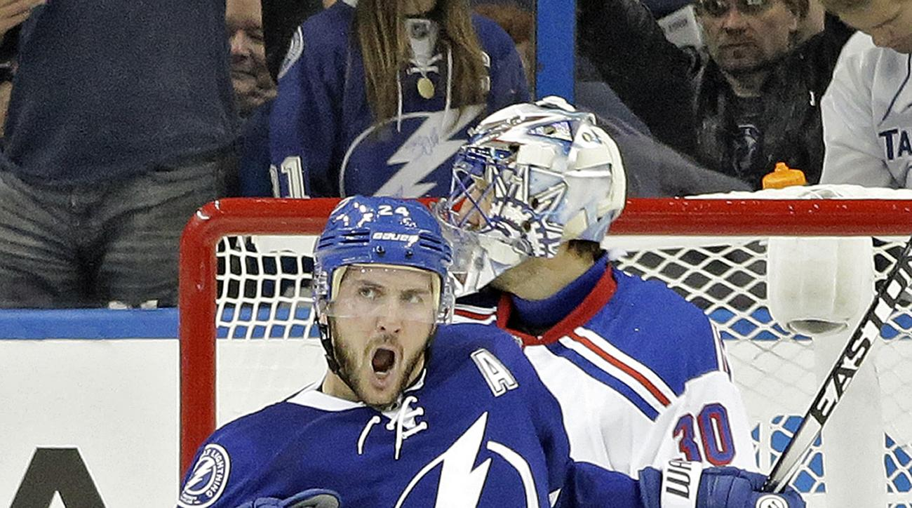 FILE - In this Nov. 26, 2014, file photo, Tampa Bay Lightning right wing Ryan Callahan (24) celebrates his goal past New York Rangers goalie Henrik Lundqvist during the first period of an NHL hockey game in Tampa, Fla. The New York Rangers will see some v