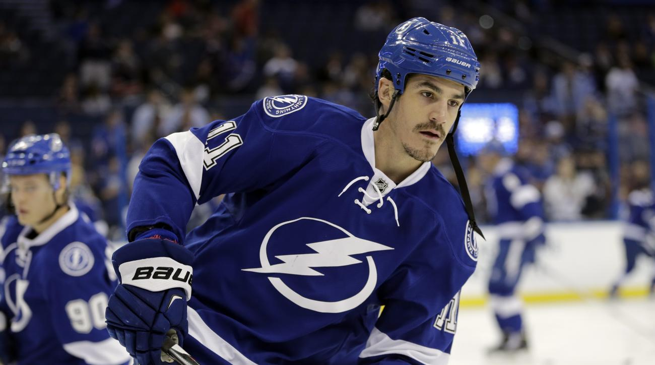 FILE - In this Nov. 26, 2014, file photo, Tampa Bay Lightning center Brian Boyle (11) skates before an NHL hockey game against the New York Rangers in Tampa, Fla. The New York Rangers will see some very familiar faces in the lineup of their opponent in th