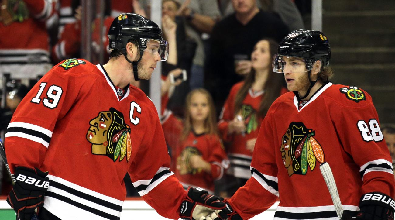 ADVANCE FOR WEEKEND EDITIONS, MAY 15-17 - FILE - In this April 25, 2015, file photo, Chicago Blackhawks center Jonathan Toews, left, celebrates with right wing Patrick Kane after scoring a goal during the first period in Game 6 of an NHL Western Conferenc
