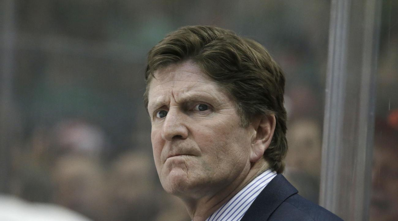 Detroit Red Wings head coach Mike Babcock watches from the bench during the first period of an NHL hockey game against the Dallas Stars Saturday, Feb. 21, 2015, in Dallas. (AP Photo/LM Otero)
