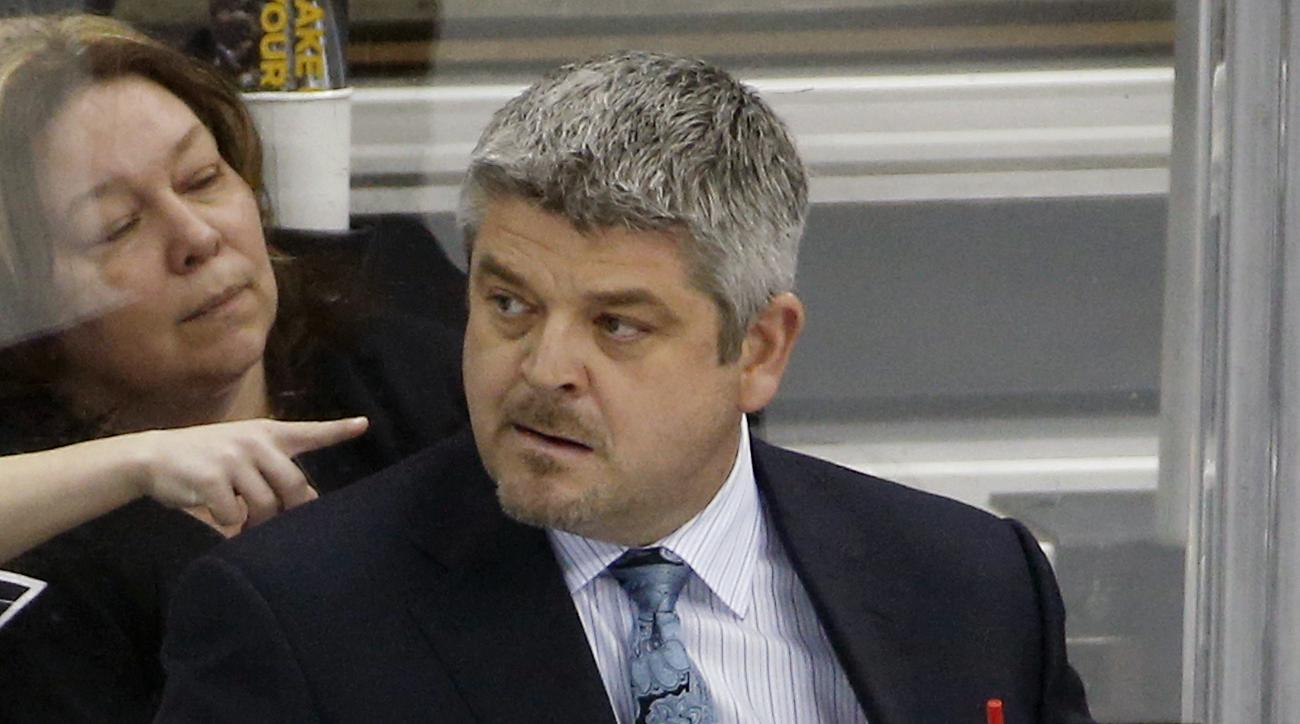 San Jose Sharks head coach Todd McLellan stands behind his bench in the third period of an NHL hockey game against the Pittsburgh Penguins in Pittsburgh Sunday, March 29, 2015. The Penguins won in a shootout 3-2. (AP Photo/Gene J. Puskar)