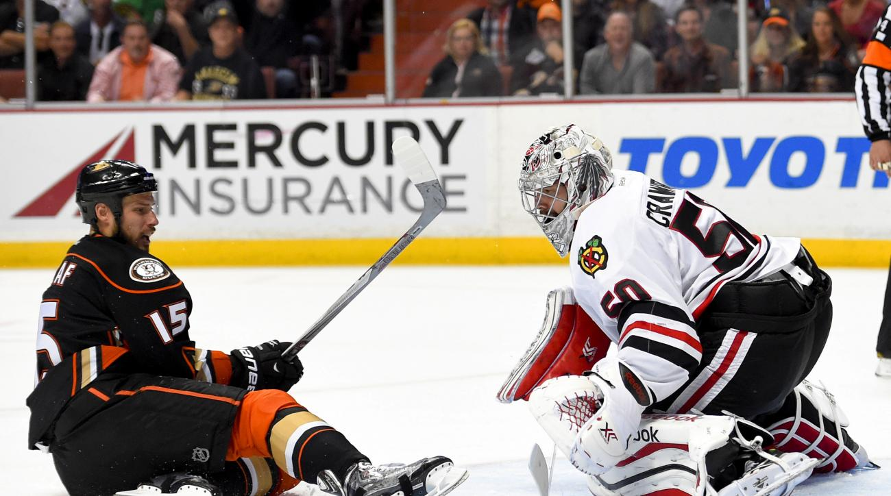 Chicago Blackhawks goalie Corey Crawford, right, blocks a shot by Anaheim Ducks center Ryan Getzlaf during overtime in Game 2 of the Western Conference final during the NHL hockey Stanley Cup playoffs in Anaheim, Calif., on Tuesday, May 19, 2015. (AP Phot